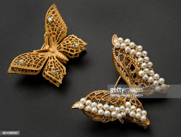 close-up of ornaments over grey background - brooch stock pictures, royalty-free photos & images