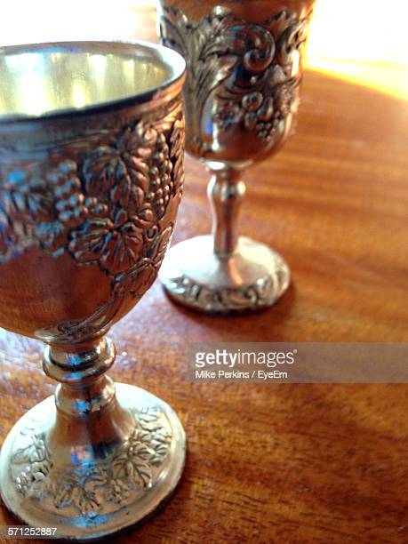 Close-Up Of Ornate Cups On Table