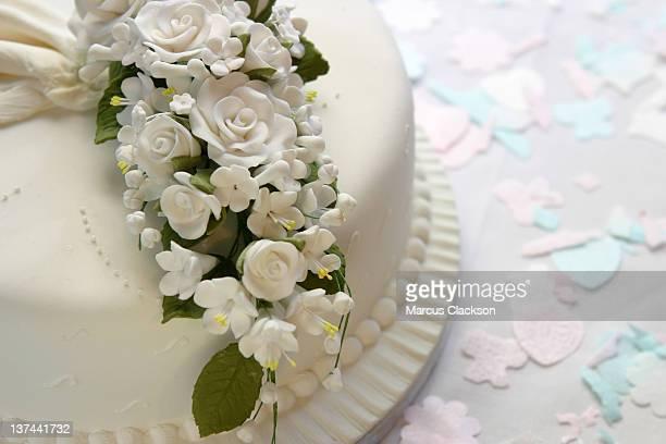 Closeup of ornate white wedding cake