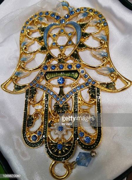 close-up of ornated hamsa - a good luck charm - hand of fatima stock photos and pictures