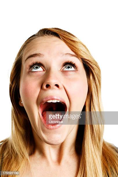 close-up of overjoyed young blonde woman looking up - mouth open stock pictures, royalty-free photos & images