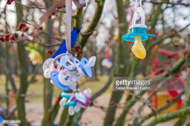 close-up of pacifiers against blurred background - köpenick stock pictures, royalty-free photos & images
