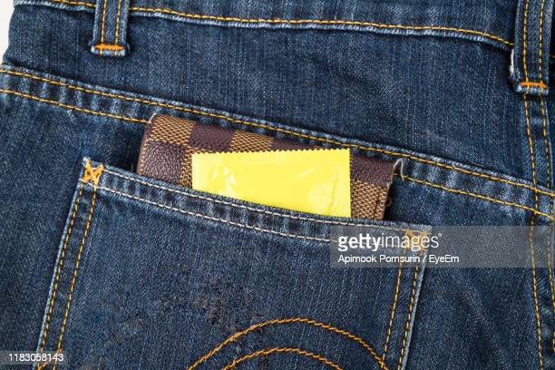 close-up of packet in jeans pocket - trousers stock pictures, royalty-free photos & images