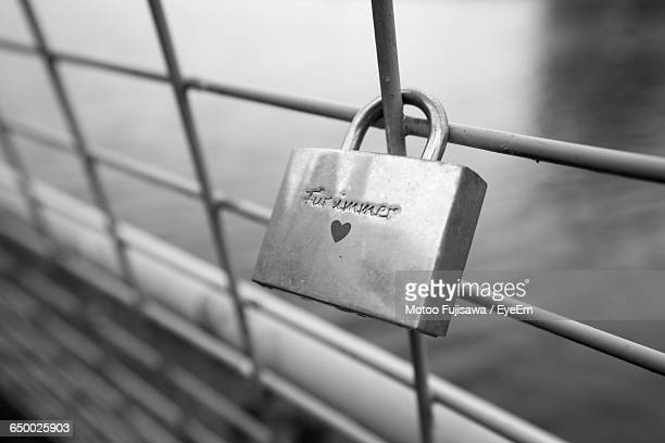 Close-Up Of Padlock Attached On Fence