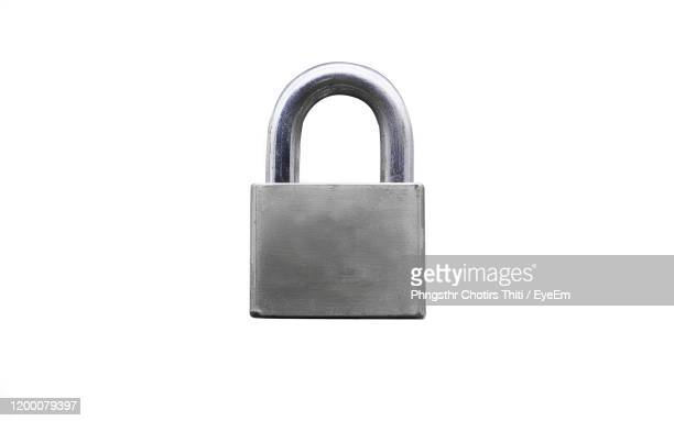 close-up of padlock on white background - locking stock pictures, royalty-free photos & images
