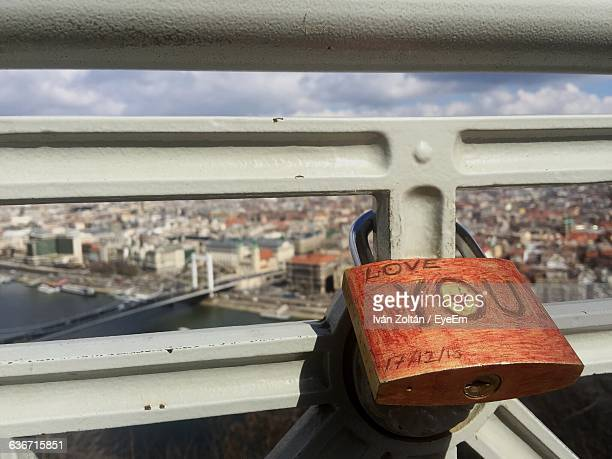 close-up of padlock with text hanging on railing - iván zoltán stock pictures, royalty-free photos & images