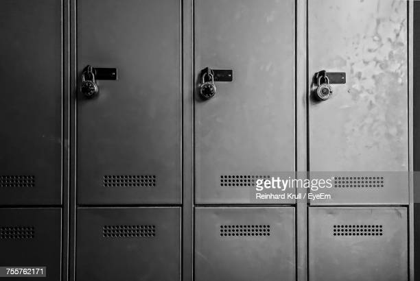 Close-Up Of Padlocks On Metallic Lockers