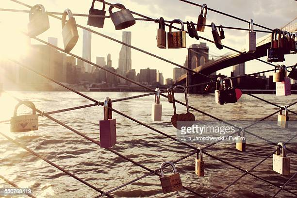 Close-Up Of Padlocks On Railing Against Water