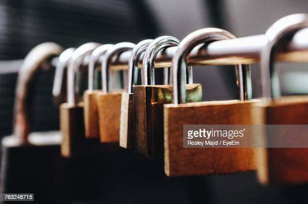 close-up of padlocks on railing - locking stock pictures, royalty-free photos & images