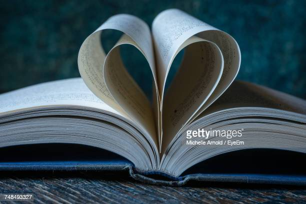 Close-Up Of Pages Folded In Heart Shape
