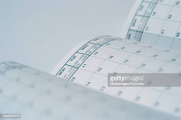 Close-up of pages of a calendar