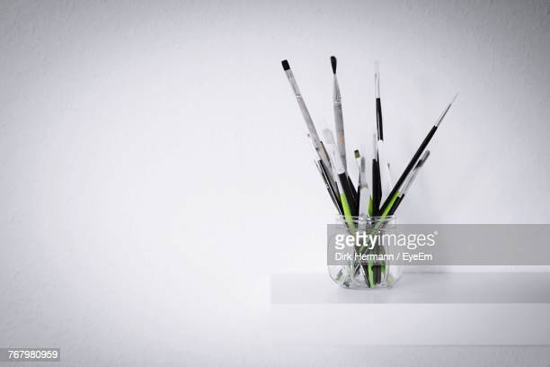 Close-Up Of Paint Brushes Against White Background