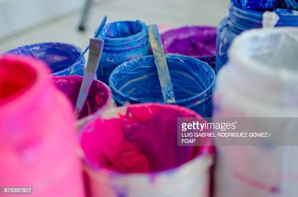 Close-up of paint cans
