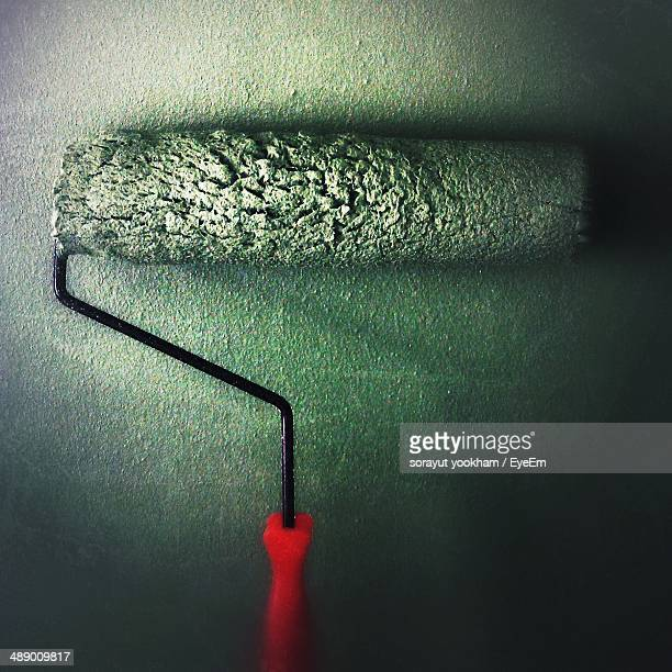 Close-up of paint roller brush against wall