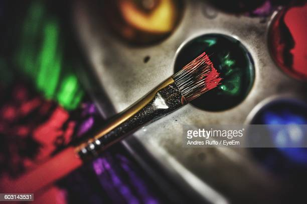 close-up of paintbrush and palette - andres ruffo stock photos and pictures