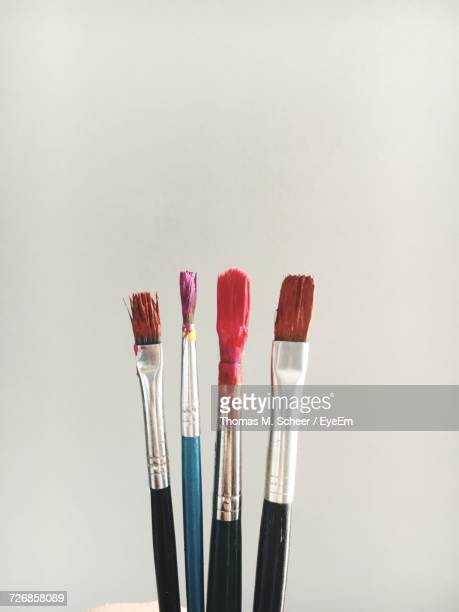 Close-Up Of Paintbrushes Against White Background