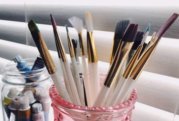 Close-Up Of Paintbrushes In Jar