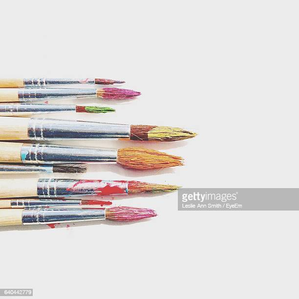 close-up of paintbrushes on white background - paintbrush stock pictures, royalty-free photos & images