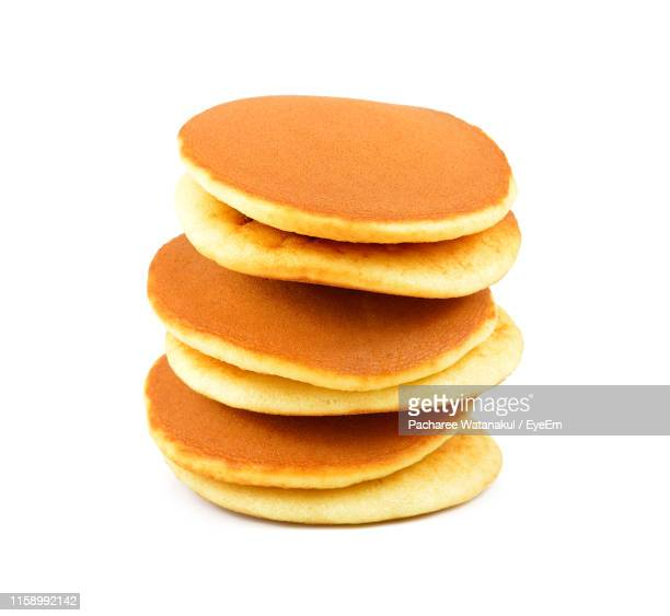 close-up of pancake against white background - pancakes stock pictures, royalty-free photos & images