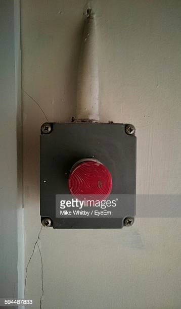Close-Up Of Panic Button On Wall