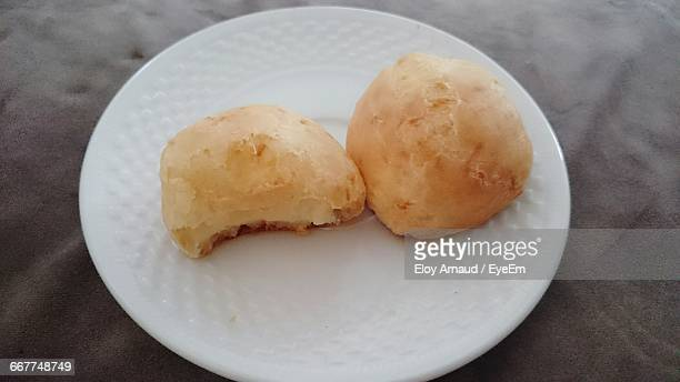 close-up of pao de queijo in plate on table - queijo ストックフォトと画像