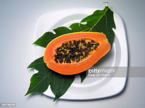 close-up of papaya against gray background - papaya stock photos and pictures
