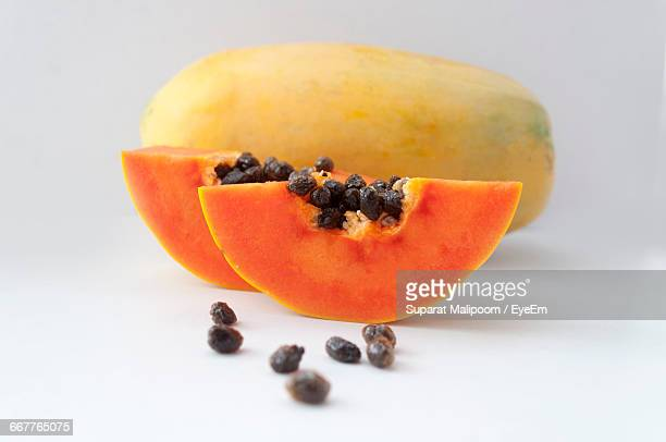 close-up of papayas slices on white background - papaya stock photos and pictures