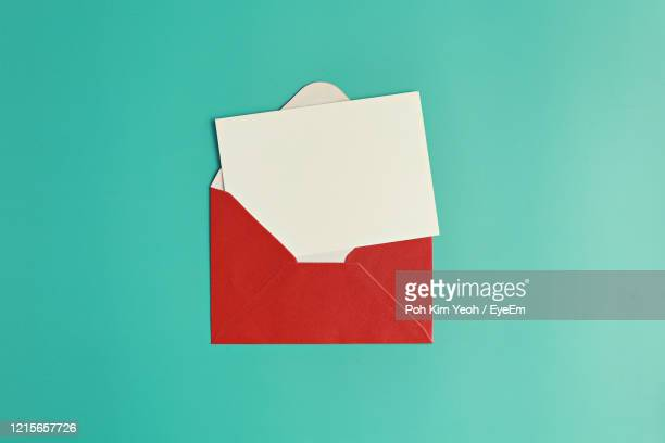 close-up of paper against blue background - message stock pictures, royalty-free photos & images