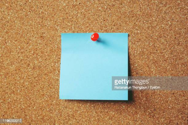 close-up of paper against brown background - adhesive note stock pictures, royalty-free photos & images