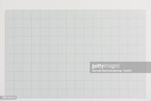 close-up of paper against white background - lined paper stock photos and pictures