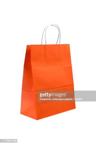 close-up of paper bag against white background - 買い物袋 ストックフォトと画像
