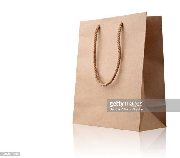 close-up of paper bag against white background - shopping bag stock pictures, royalty-free photos & images