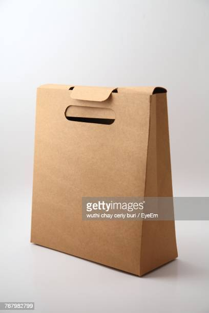 Close-Up Of Paper Bag Over White Background