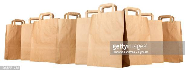 close-up of paper bags against white background - grocery bag stock pictures, royalty-free photos & images