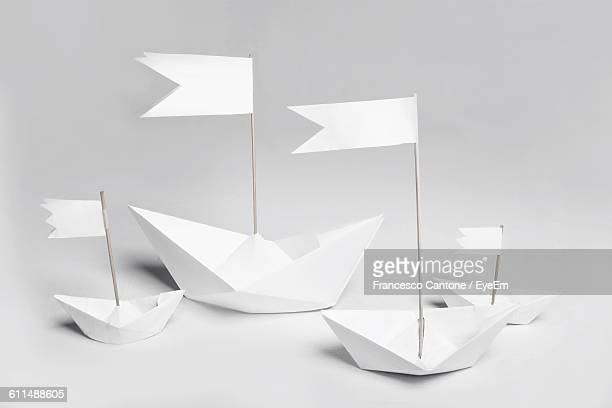 Close-Up Of Paper Boat Against White Background