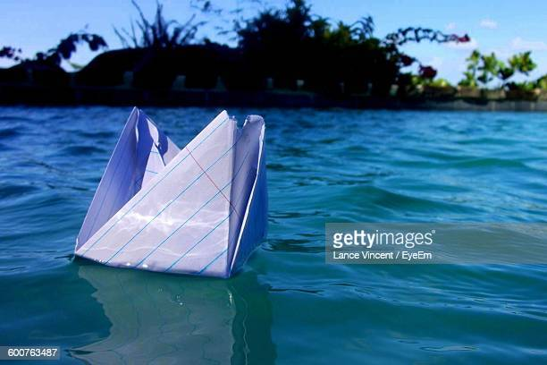 Close-Up Of Paper Boat Floating On Lake