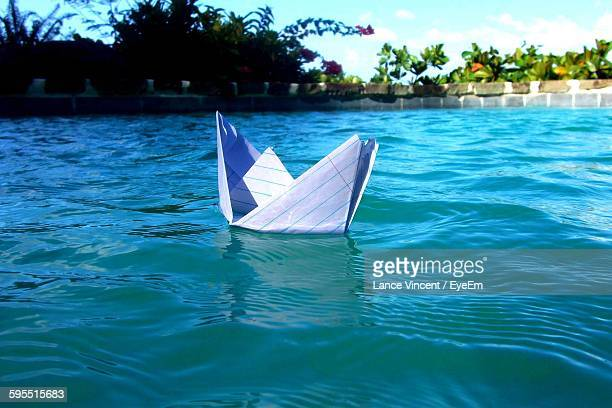 Close-Up Of Paper Boat Floating On Pond