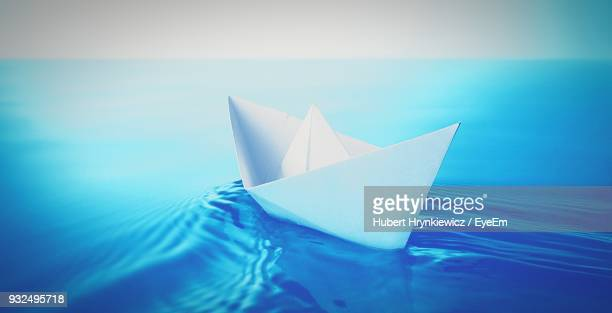 Close-Up Of Paper Boat Floating On Water