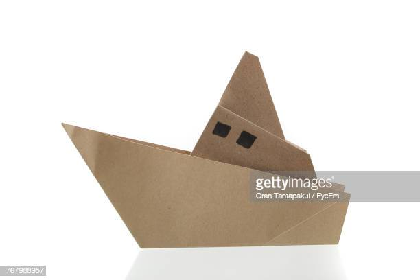 Close-Up Of Paper Boat Over White Background