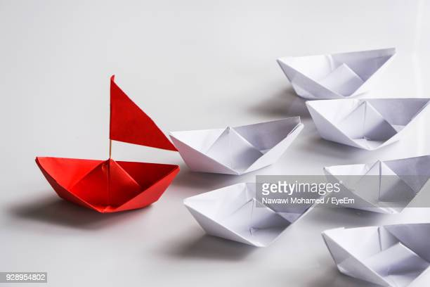 Close-Up Of Paper Boats Over White Background