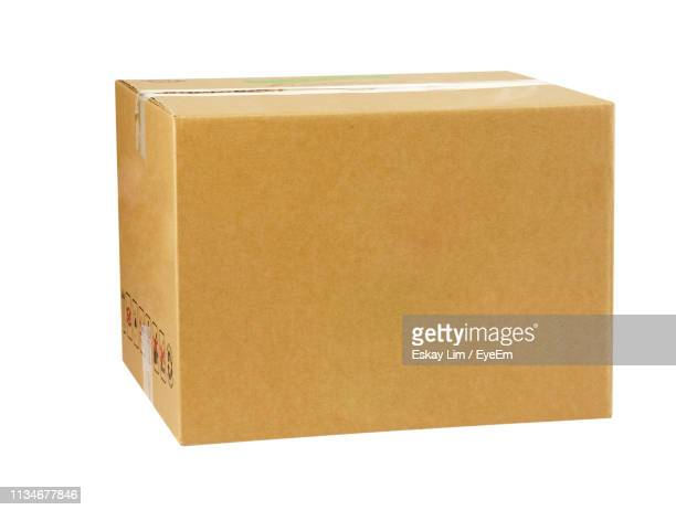 close-up of paper box over white background - package stock pictures, royalty-free photos & images