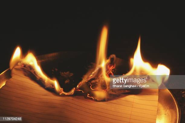 close-up of paper burning in darkroom - burns night stock pictures, royalty-free photos & images