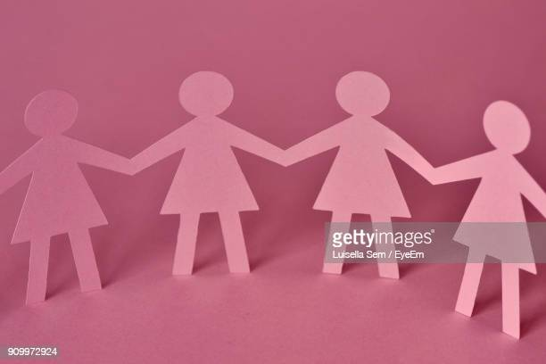 close-up of paper chain over pink background - chain object stock pictures, royalty-free photos & images