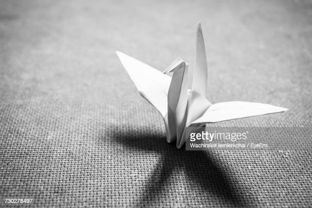 Close-Up Of Paper Crane On Table