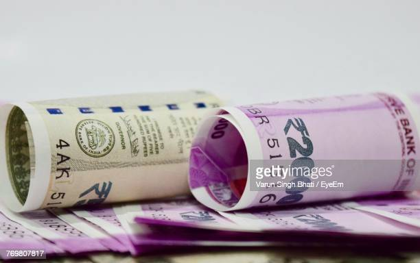 Close-Up Of Paper Currency Against White Background