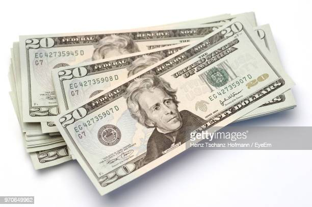 close-up of paper currency against white background - dollar sign stock pictures, royalty-free photos & images