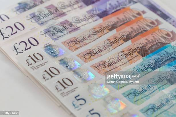 close-up of paper currency arranged on table - money stock photos and pictures