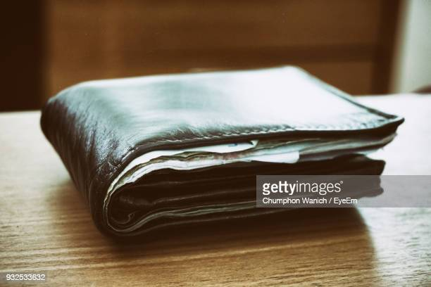 close-up of paper currency in wallet on table - wallet stock pictures, royalty-free photos & images