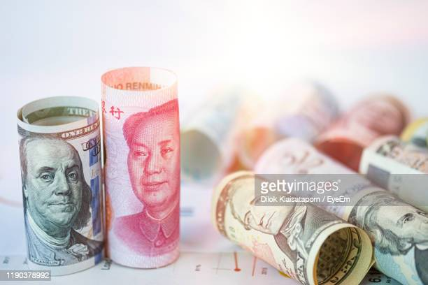 close-up of paper currency on table against white background - trade war stock pictures, royalty-free photos & images