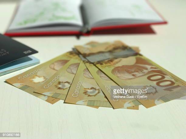Close-Up Of Paper Currency On Table